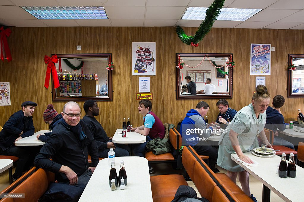 Diners in Nathan's Pies and Eels cafe in Upton Park on December 3, 2016 in London, England. West Ham United played Arsenal in a Premier League match on December 3, which marks more than six months since the football club moved from their Boleyn Ground stadium in Upton Park to the London Stadium in Stratford. Local businesses are suffering as the former West Ham United ground is being demolished to make way for more than 800 homes.