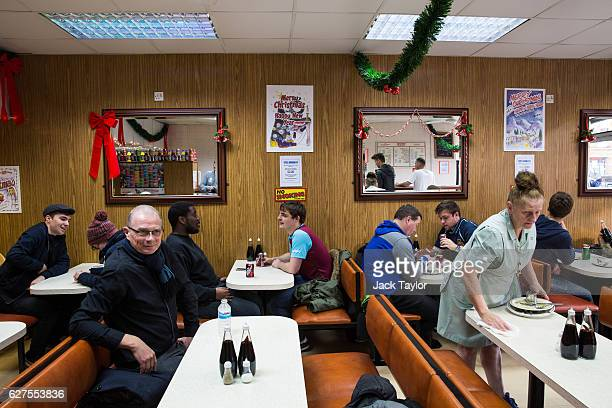 Diners in Nathan's Pies and Eels cafe in Upton Park on December 3 2016 in London England West Ham United played Arsenal in a Premier League match on...