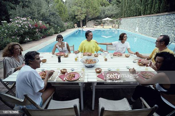 Diners sitting around a table with a swimming pool beyond as they enjoy lunch at Peppone on the island of Capri Italy in September 1989