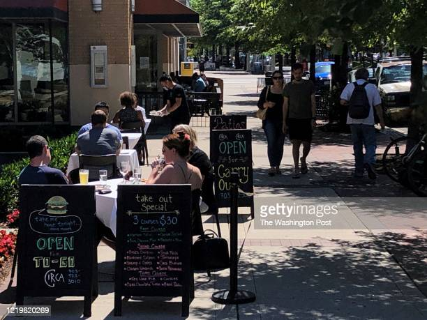 Diners take advantage of a mild summer day and the further opening of business in as the state moves into Phase II of reopening in this age of the...