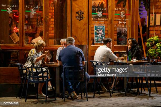 Diners take their last chance at a restaurant in Takapuna before the lockdown commences on February 14, 2021 in Auckland, New Zealand. Auckland will...
