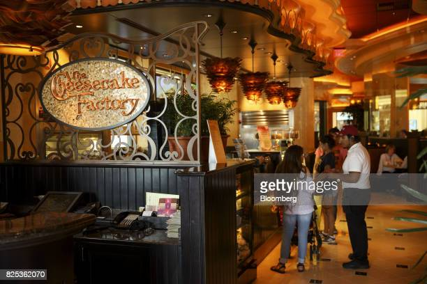 Diners wait at a Cheesecake Factory Inc restaurant in the Canoga Park neighborhood of Los Angeles California US on Tuesday Aug 1 2017 The Cheesecake...