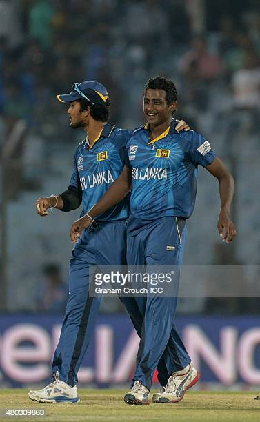 Dinesh Chandimal and Ajantha Mendis of Sri Lanka celebrate another wicket during the Sri Lanka v The Netherlands match at the ICC World Twenty20...