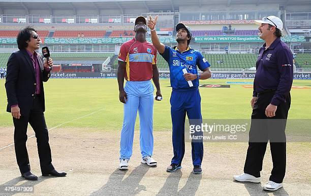 Dinesh Chandimal captain of Sri Lanka tosses the coin as Darren Sammy captain of the West Indies looks on the ICC World Twenty20 Bangladesh 2014 Warm...