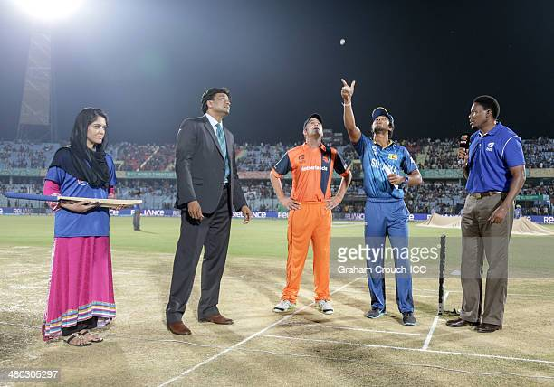 Dinesh Chandimal captain of Sri Lanka tosses the coin with Peter Borren captain of The Netherlands match referee Javagal Srinath and Pepsi mascot...