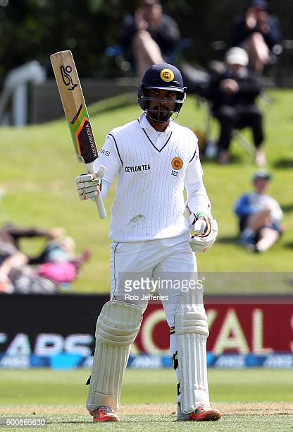 Dinesh Chandimal of Sri Lanka acknowledges the crowd after scoring 50 runs during day two of the First Test match between New Zealand and Sri Lanka...