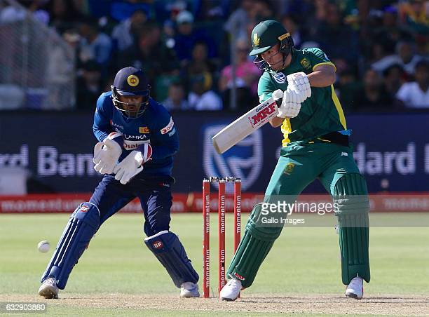 Dinesh Chandimal of Sri Lanka and AB de Villiers of South Africa during the 1st One Day International match between South Africa and Sri Lanka at St...
