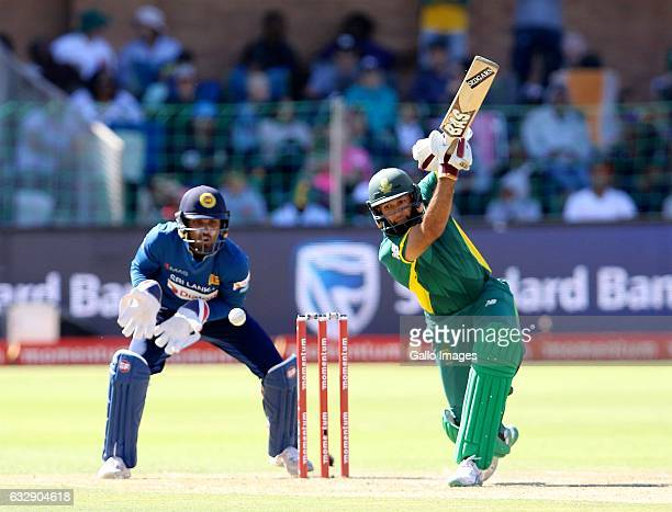 Dinesh Chandimal of Sri Lanka and Hashim Amla of South Africa during the 1st One Day International match between South Africa and Sri Lanka at St...