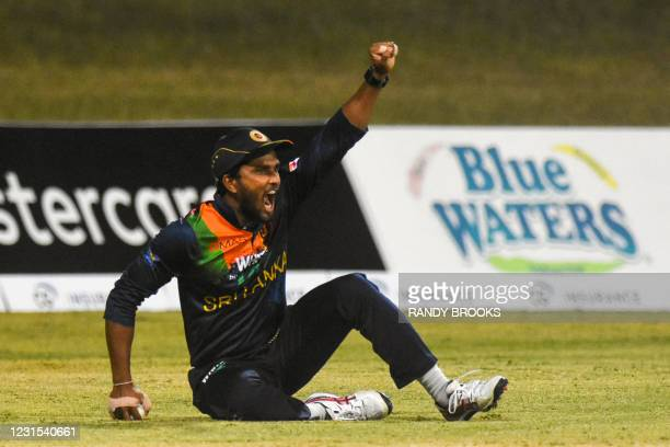 Dinesh Chandimal of Sri Lanka celebrates taking catch to dismiss Kieron Pollard of West Indies during the 2nd T20i match between Sri Lanka and West...