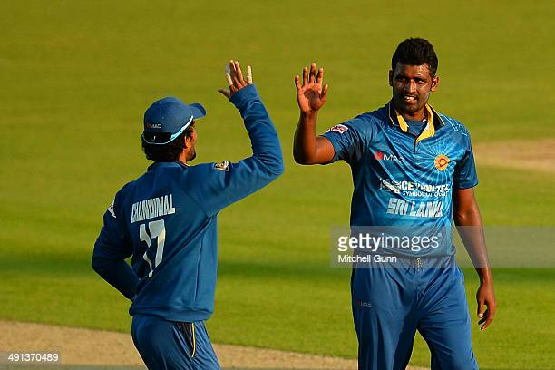 Dinesh Chandimal of Sri Lanka congratulates Thissara Perera of Sri Lanka after taking the wicket of Sam Northeast of Kent during the one day match...