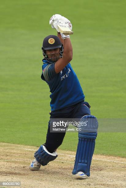 Dinesh Chandimal of Sri Lanka drives the ball towards the boundary during the ICC Champions Trophy Warmup match between New Zealand and Sri Lanka at...