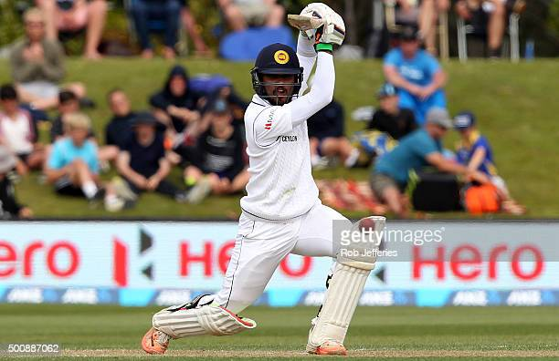 Dinesh Chandimal of Sri Lanka drives through cover for 4 during day two of the First Test match between New Zealand and Sri Lanka at University Oval...