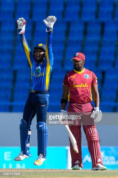 Dinesh Chandimal of Sri Lanka has an unsuccessful appeal against Darren Bravo of West Indies during the 3rd and final ODI match between West Indies...