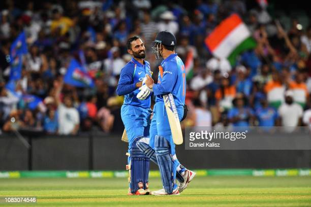 Dinesh Karthik of India celebrates with MS Dhoni of India after deferating Australia during game two of the One Day International series between...