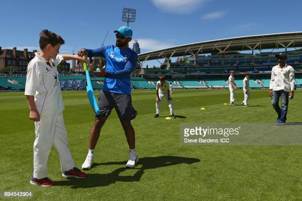 Dinesh Karthik of India coaches local children during the ICC Cricket For Good coaching session with India at The Kia Oval on June 10 2017 in London...