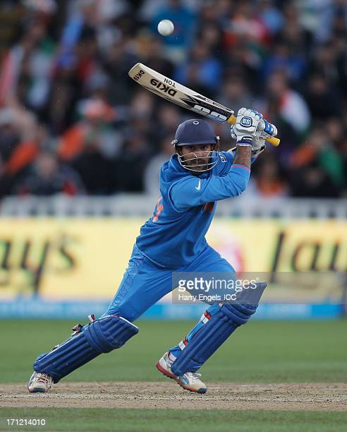 Dinesh Karthik of India hits out during the ICC Champions Trophy final between England and India at Edgbaston on June 23 2013 in Birmingham England