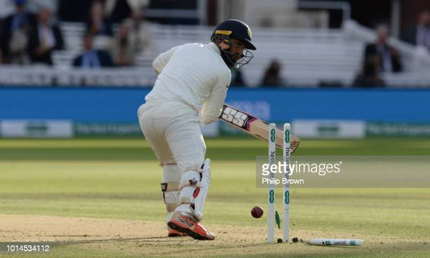 Dinesh Karthik of India is bowled during the 2nd Specsavers Test Match between England and India at Lord's Cricket Ground on August 10 2018 in London...