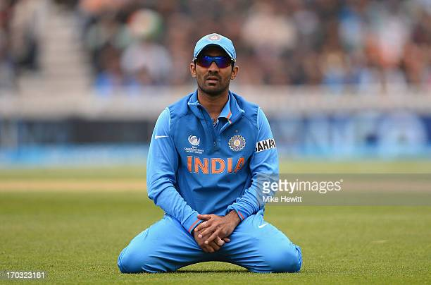 Dinesh Karthik of India kneels after failing to stop a boundary during the ICC Champions Trophy Group B match between India and West Indies at The...