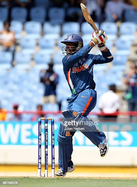 Dinesh Karthik of India scores runs durring The ICC World Twenty20 Group C match between South Africa and India played at The Beausejour Cricket...