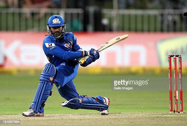 Dinesh Karthik of Mumbai bats during the Champions League twenty20 match between Sydney Sixers and Mumbai Indians at Sahara Stadium Kingsmead on...