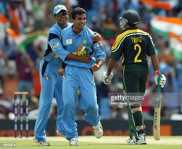 Dinesh Mongia of India congratulates team-mate Zaheer Khan on the wicket of Taufeeq Umar of Pakistan during the ICC Cricket World Cup 2003 Pool A...