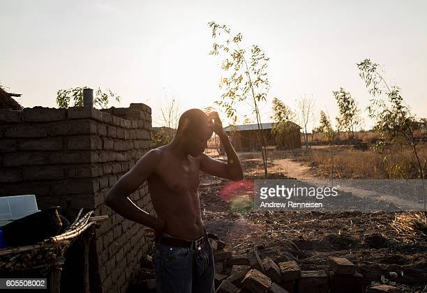Dinesi Majawa pauses after watering his garden at his family home in the village of Masale which lies in one of the areas most affected by drought on...