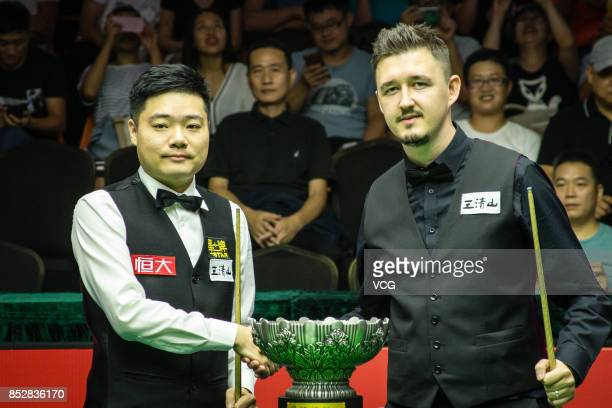 Ding Junhui of China and Kyren Wilson of England pose with the trophy before the final match on day seven of the World Open 2017 on September 24 2017...