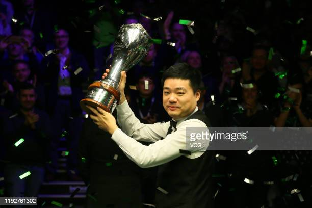Ding Junhui of China celebrates with his trophy after winning the final match against Stephen Maguire of Scotland on day 13 of 2019 Betway UK...