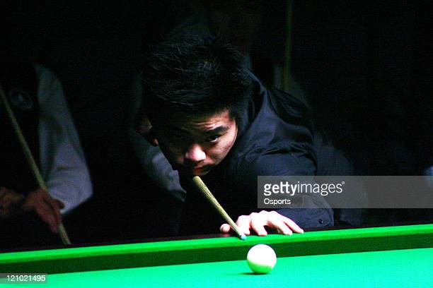 Ding Junhui of China considers his shot options during the Men's Snooker Team match between China and Macau at the 15th Asian Games in Doha Qatar on...