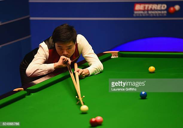 Ding Junhui of China in action during his quarter final match against Mark Williams of Wales on day eleven of the World Championship Snooker at...