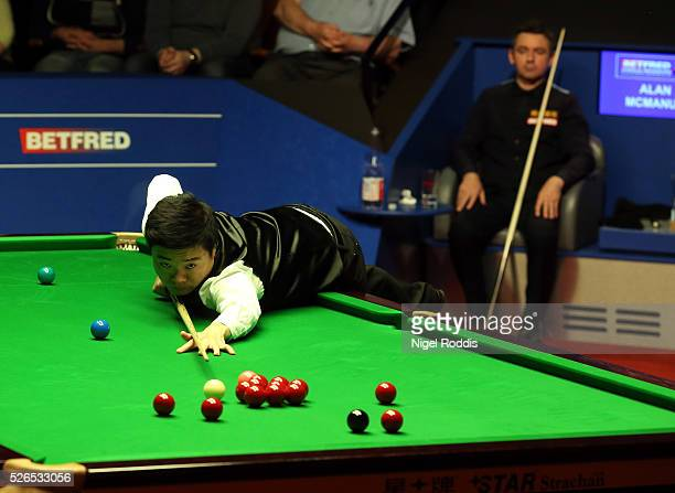 Ding Junhui of China in action during his semi final match against Alan McManus of Scotland on day fourteen of the World Championship Snooker at...