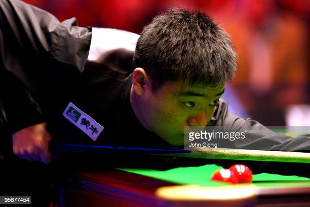 Ding Junhui of China lines up a shot during his match against Mark Selby of England in the PokerStarscom Masters Snooker tournament at Wembley Arena...