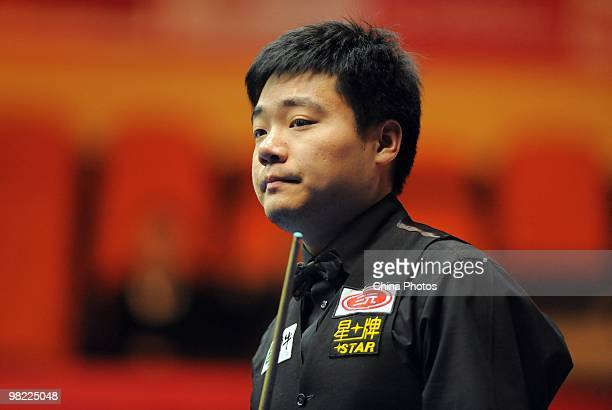 Ding Junhui of China looks on during his quarterfinal match against Peter Ebdon of England during the 5th day of 2010 World Snooker China Open at...