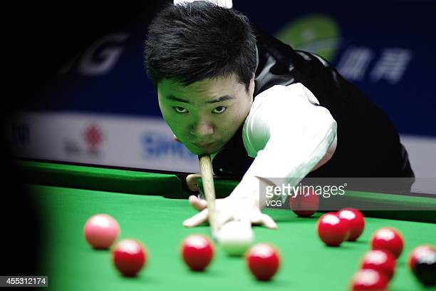 Ding Junhui of China plays a shot against Graeme Dott of Scotland during day five of the World Snooker Bank of Communications OTO Shanghai Masters...