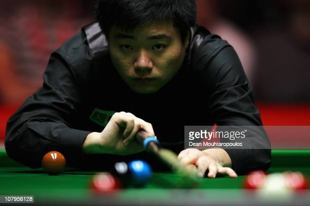 Ding Junhui of China plays a shot in his Round One match against Mark Williams of Wales during The Ladbrokesmobile Masters on Day 2 at Wembley Arena...