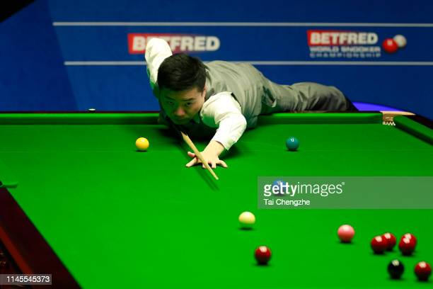 Ding Junhui of China plays a shot in the second round match against Judd Trump of England during day eight of the 2019 Betfred World Snooker...