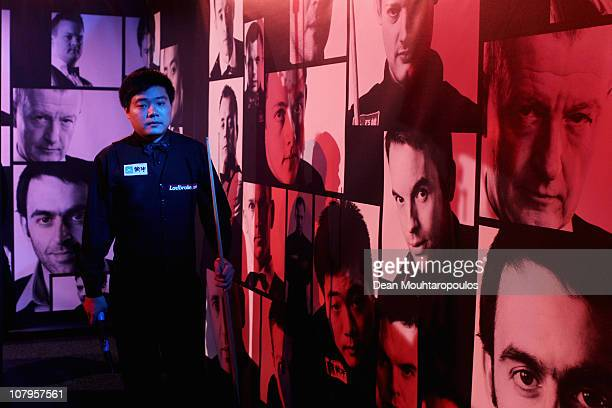 Ding Junhui of China poses after winning his Round One match against Mark Williams of Wales during The Ladbrokesmobile Masters on Day 2 at Wembley...