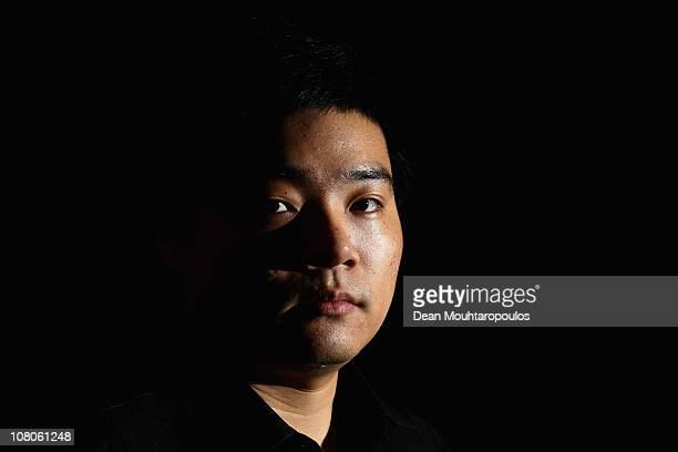 Ding Junhui of China poses for a photo after his victory against Jamie Cope of England in their semi final match at The Ladbrokesmobile Masters on...