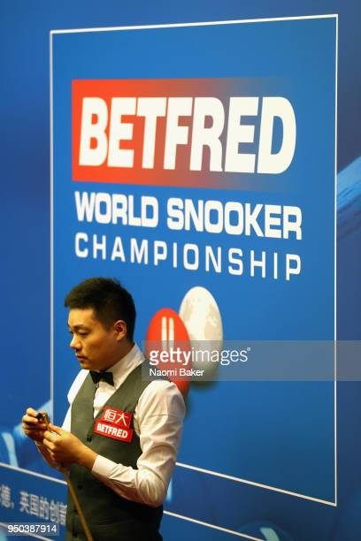Ding Junhui of China prepares to take a shot during his first round match against Xiao Guodong of China of during day three of the World Snooker...