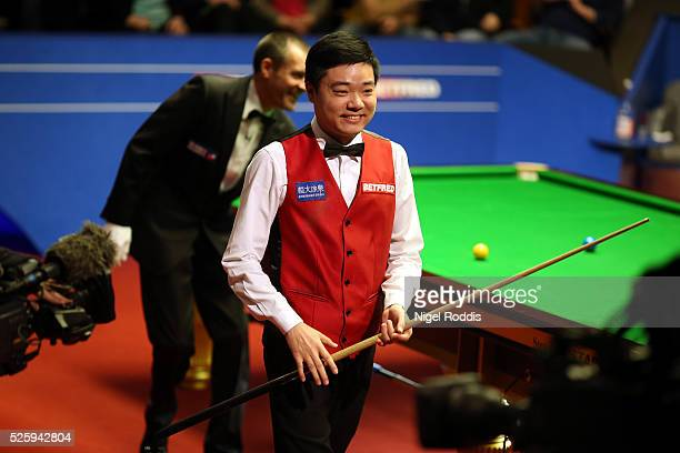 Ding Junhui of China reacts after the first session during his semi final match against Alan McManus of Scotland on day fourteen of the World...