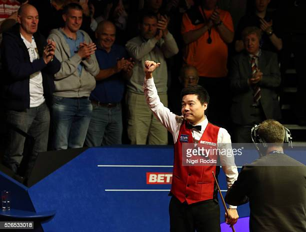 Ding Junhui of China reacts after winning his semi final match against Alan McManus of Scotland on day fourteen of the World Championship Snooker at...
