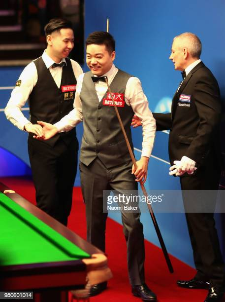Ding Junhui of China shakes hands at the end of the match after winning his first round match against Xiao Guodong of China of during day four of the...