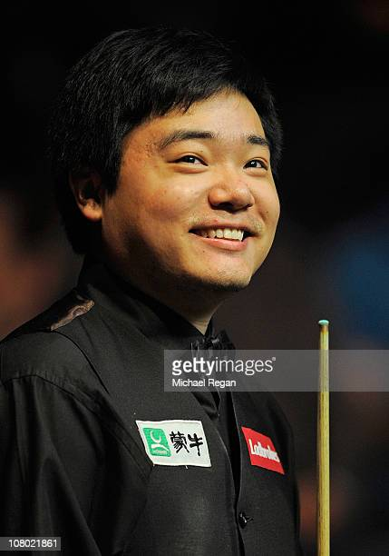 Ding Junhui of China smiles after winning the Ladbrokesmobile Masters quarterfinal match against Graeme Dott of Scotland at Wembley Arena on January...