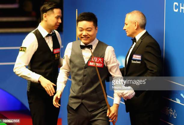 Ding Junhui of China walks off stage after winning his first round match against Xiao Guodong of China of during day four of the World Snooker...