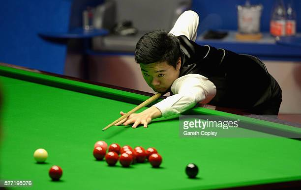 Ding Junhui plays a shot against Mark Selby during the World Snooker Championship final at the Crucible Theatre on May 02 2016 in Sheffield England