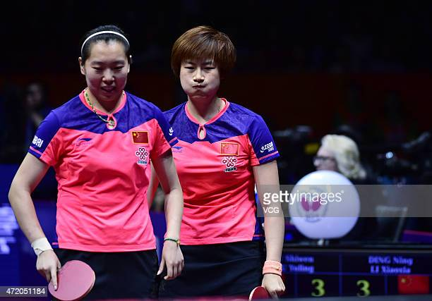 Ding Ning and Li Xiaoxia of China react against Liu Shiwen and Zhu Yuling of China during women's doubles final match on day eight of the 2015 World...