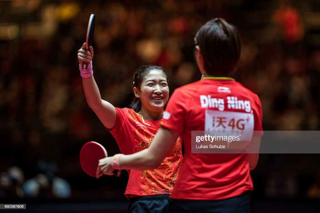 Ding Ning (R) and Liu Shiwen (L) of China celebrate after winning the Women's Doubles Final match during the Table Tennis World Championship at Messe Duesseldorf on June 5, 2017 in Dusseldorf, Germany.