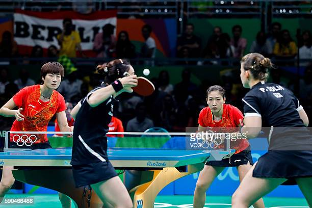 Ding Ning and Liu Shiwen of China compete against Petrissa Solja and Shan Xiaona of Germany in the Women's Team Gold Medal Team Match between China...