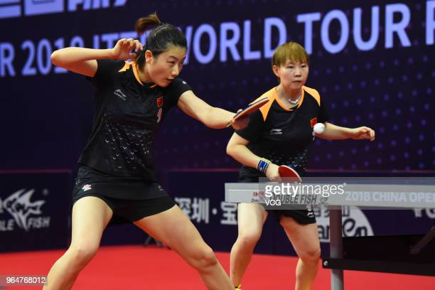 Ding Ning and Zhu Yuling of China compete in the Women's Doubles semifinal match against Hayata Hina and Ito Mima of Japan during day two of the 2018...