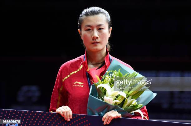 Ding Ning of China attends awarding ceremony after women's singles final match against Wang Manyu of China on day four of the 2018 ITTF World Tour...